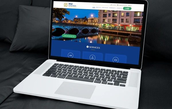 Laptop on sofa showing Sligo Chamber of Commerce website open